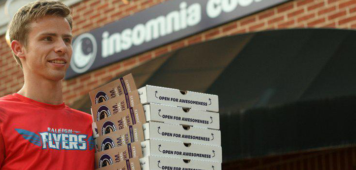 Insomnia Cookies dishing cookies