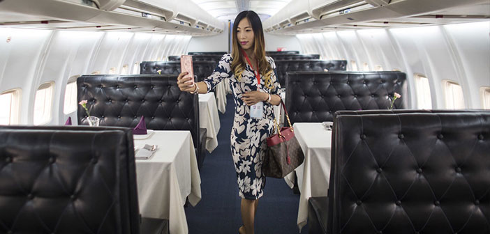 "A woman poses for a ""selfi"" inside the Lily Airways, the first plane-restaurant China."