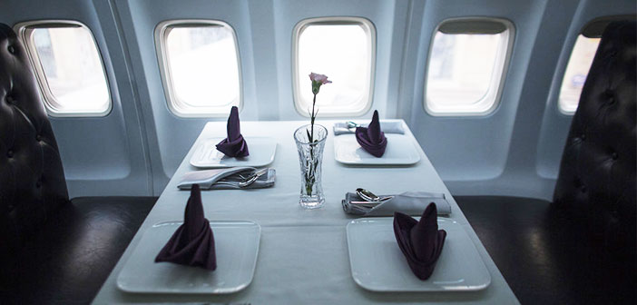 A table restaurant inside the plane.