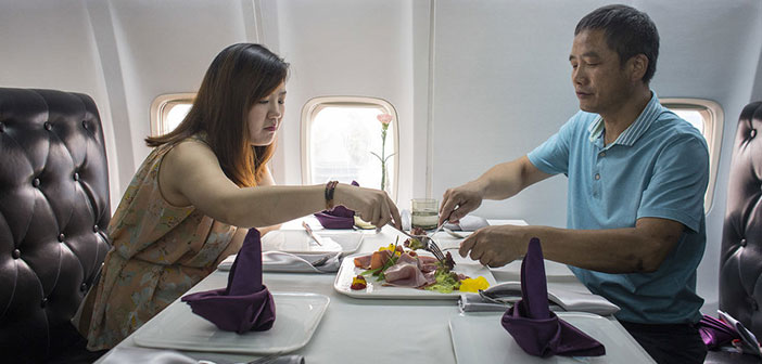 Diners enjoy a meal inside the plane-restaurant located in the heart of downtown Wuhan, Hubei Province, China.